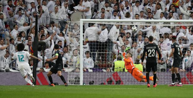 Real Madrid's Marcelo scores their third goal.