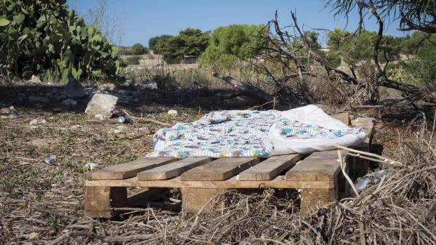 A makeshift bed on a pallet close to the cow farm. Photo: Marc Aaron Orchard