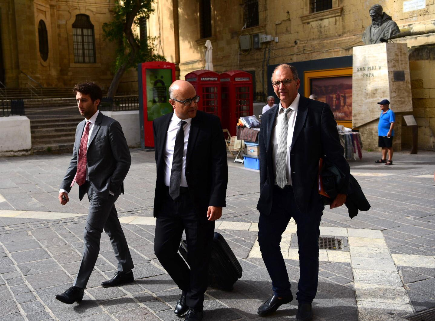 Matthew Caruana Galizia (left) and his father Peter (right) walk to court together with lawyer Jason Azzopardi last Monday. Photo: Mark Zammit Cordina