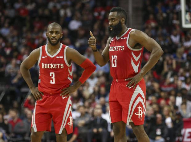 Houston Rockets guard James Harden (13) gives a thumbs up as guard Chris Paul (3) looks on during the second quarter against the Golden State Warriors at Toyota Center. Mandatory Credit: Troy Taormina-USA TODAY Sports