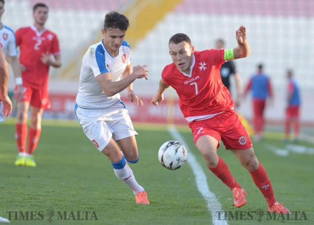 Malta's Ryan Camenzuli tries to make his way past the Czech Republic's defence during their UEFA U21 Championship qualifying match at the National Stadium in Ta'Qali on March 29. Photo: Matthew Mirabelli
