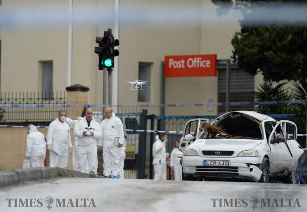 Police officers use a drone during investigations into a car bomb that killed Victor Calleja, 65, of Ħamrun on January 29. Photo: Matthew Mirabelli
