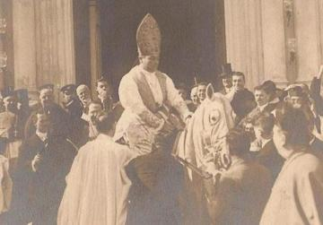 Caruana mounted on a white mare outside St Mark's church, Rabat, at the beginning of the solemn ingresso.