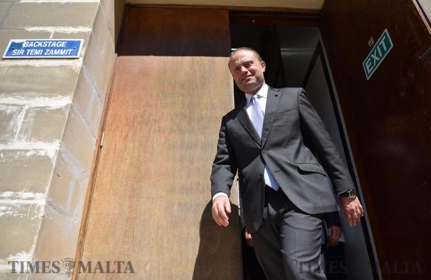Prime Minister Joseph Muscat walks out from the back door moments after he took part in a political debate held at the University of Malta on May 17. Photo: Mark Zammit Cordina