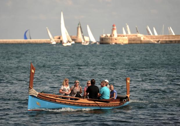 Tourists ride a traditional Maltese boat in Grand Harbour on October 21. Photo: Chris Sant Fournier