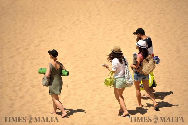 Beach lovers walk across the Golden Sands of Golden Bay on June 21. Photo: Chris Sant Fournier