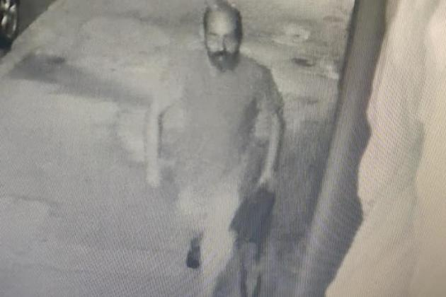 Caught on camera stealing laptop from car