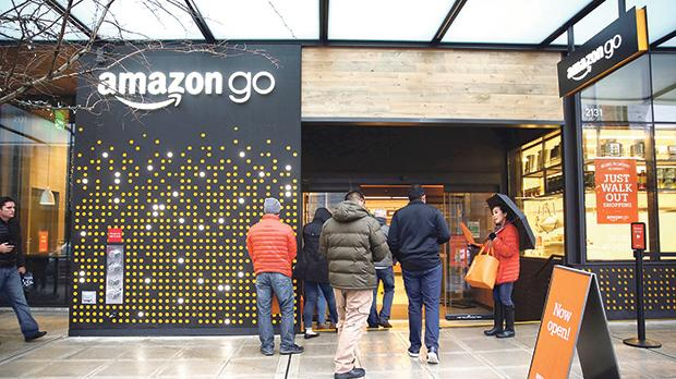 People are offered free reusable bags as they enter the new Amazon Go store at Amazon's headquarters in Seattle, Washington, US. Photo: Reuters