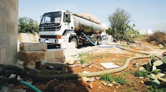 Water being extracted from an illegal borehole.