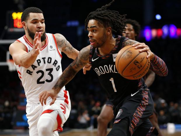 Brooklyn Nets guard D'Angelo Russell (1) drives to the basket against Toronto Raptors guard Fred VanVleet (23) during the second half at Barclays Center. Mandatory Credit: Noah K. Murray-USA TODAY Sports