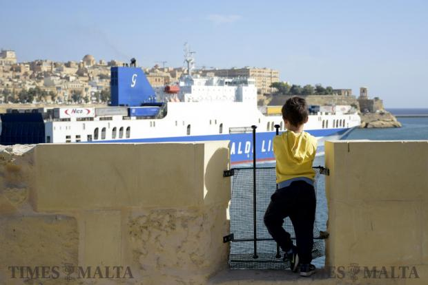 A young boy looks out from the Senglea bastions whilst a cargo ship exits the Grand harbour on May 5. Photo: Mark Zammit Cordina