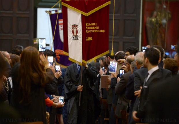 Graduates enter the Jesuit Church in Valletta on December 3 as friends and relatives take photos with their ipads and mobile phones. Photo: Matthew Mirabelli
