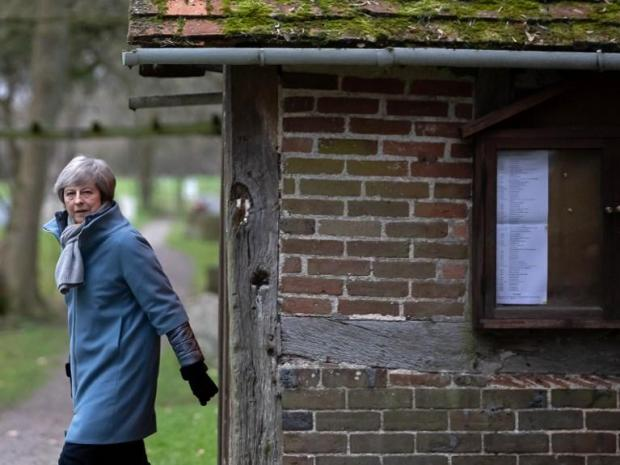 """Britain's Prime Minister Theresa May leaves after attending a church service near her Maidenhead constituency, west of London. The British Prime Minister on Sunday warned MPs preparing to vote down her EU divorce deal that failing to deliver Brexit would be a """"catastrophic and unforgivable breach of trust in our democracy""""."""