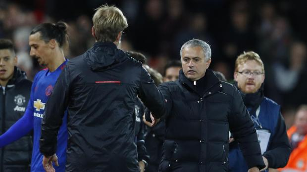Liverpool manager Juergen Klopp and Manchester United manager Jose Mourinho at the end of the match.