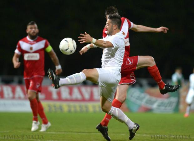 Valletta's Jean Pierre Triganza wins the ball during their Europa League match against Newtown at Hibs Stadium in Paola on July 9. Photo: Matthew Mirabelli