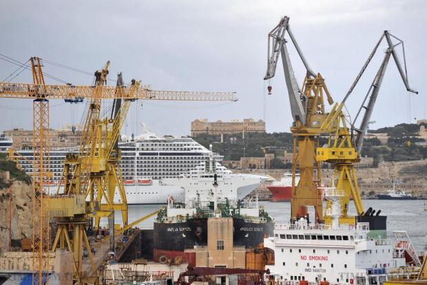 The cruise liner MSC Fantasia lies in the background with cranes from the Palumbo Shipyard in the foreground on January 26. Photo: Chris Sant Fournier