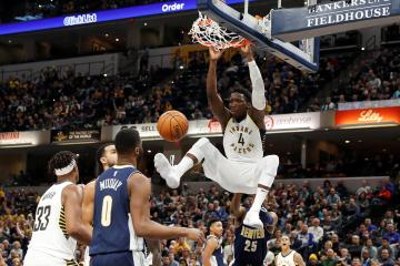 Indiana Pacers guard Victor Oladipo (4) dunks against the Denver Nuggets during the 3rd quarter at Bankers Life Fieldhouse. Photo: Brian Spurlock-USA TODAY Sports/File Photo