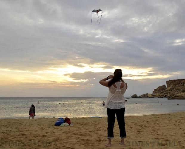 The sunset provided the perfect backdrop for some kite-flying at Għajn Tuffieħa Bay on October 1. Photo: Mark Zammit Cordina