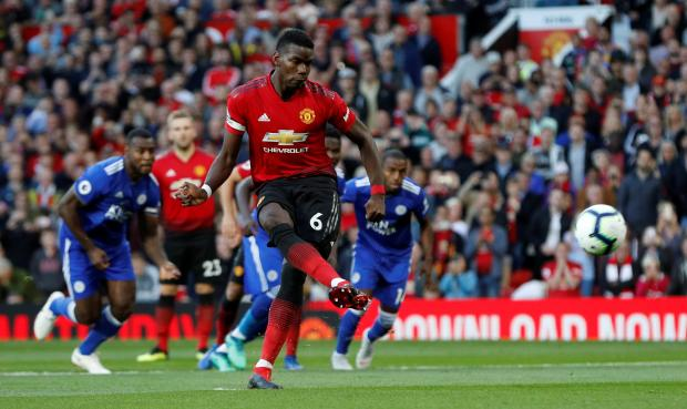 Manchester United's Paul Pogba scores their first goal from the penalty spot.