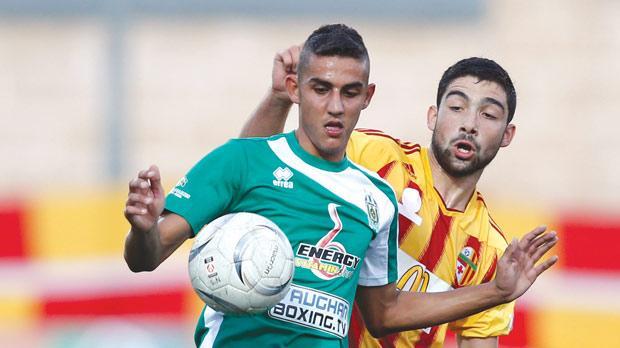 Floriana's Steve Pisani controls the ball despite the close attentions of Birkirkara's Zach Muscat. Photo: Darrin Zammit Lupi