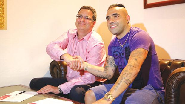 Fabrizio Miccoli (right) and Adrian Delia, the Birkirkara president, shake hands after the former signed his one-year contract with the Stripes. Photo: Mark Zammit Cordina