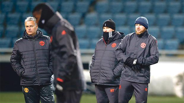 Jose Mourinho (left) before training at the Chornomorets Stadium.