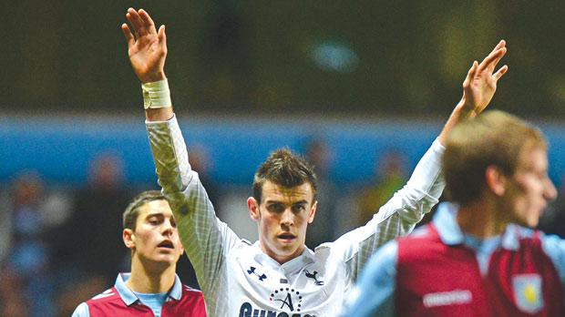 Tottenham's Gareth Bale gestures after scoring one of his three goals at Villa Park.