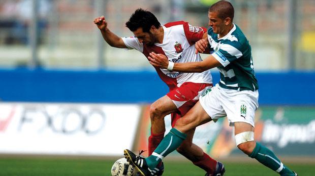 Valletta midfielder Edmond Agius (left) tries to hold off Floriana's Christian Cassar during last season's FA Trophy final. Photo: Darrin Zammit Lupi