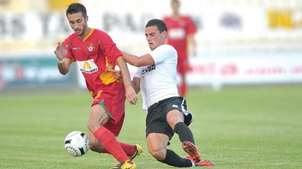 Birkirkara forward Terence Vella holds off Hibs' Clayton Failla. Photo: Stephen Gatt