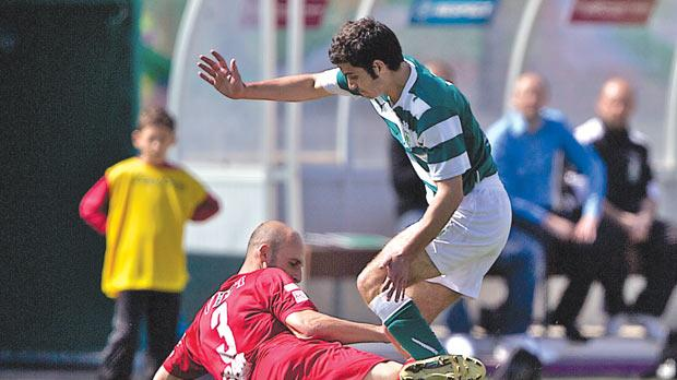 Valletta's Ian Azzopardi (grounded) and Joseph Borg, of Floriana, clash for the ball.
