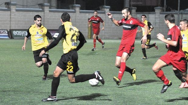 Terence Vella (centre) launches an attack for Ħamrun during their 1-0 win over Qormi. Photo: Jason Borg