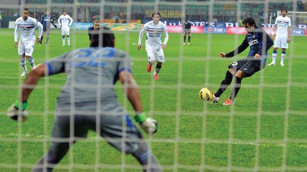 Diego Milito drives the ball home from the penalty spot for Inter's first goal in their 3-2 win over Sampdoria.
