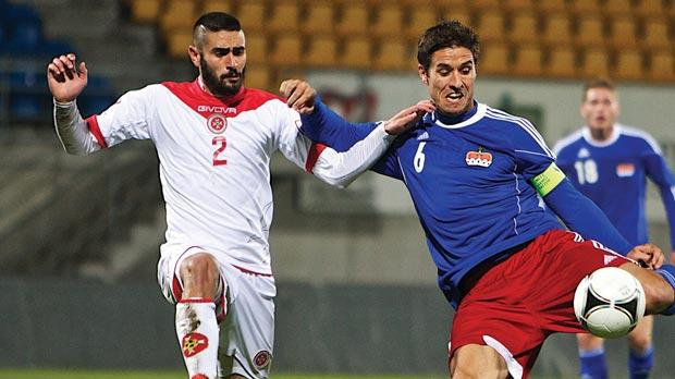 Jonathan Caruana (left) closing the way to Malta's goal yesterday. Photo: Paul Zammit Cutajar