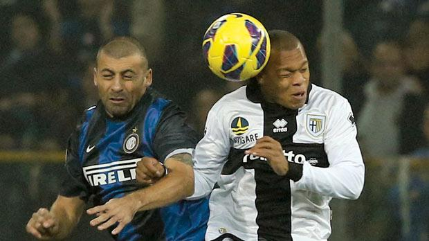 Inter's Walter Samuel in an aerial duel with Jonathan Biabiany.