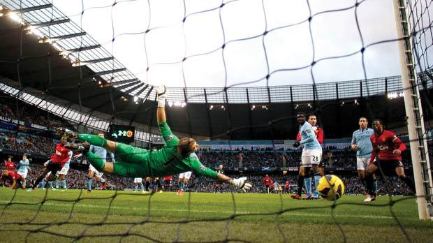 Manchester City goalkeeper Joe Hart fails to keep out Robin Van Persie's shot at the Etihad Stadium.