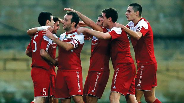 Standing tall... Melita players celebrate their opening goal in their 2-1 win over Valletta yesterday. Photo: Darrin Zammit Lupi