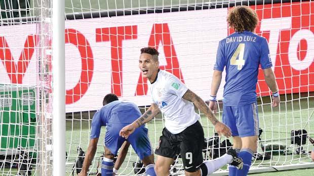 Corinthians striker Paolo Guerrero runs to his team-mates after scoring the winner against Chelsea on Sunday.