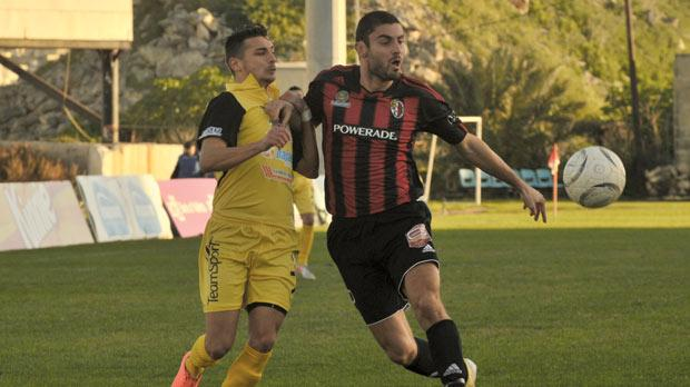 Ħamrun defender Adrian Ivanov (right) holds off Leighton Grech. Photo: Jason Borg