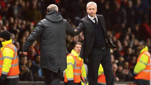 Alex Ferguson (left) shakes hands with Alan Pardew at Old Trafford on Boxing Day.