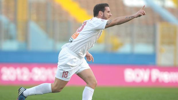 Valletta striker Ian Zammit runs to his team-mates after scoring his team's winning goal yesterday.
