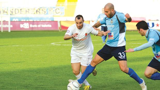 Sliema's Stefano Bianchiardi blocking the way for Michael Mifsud. Photo: Alan Carville