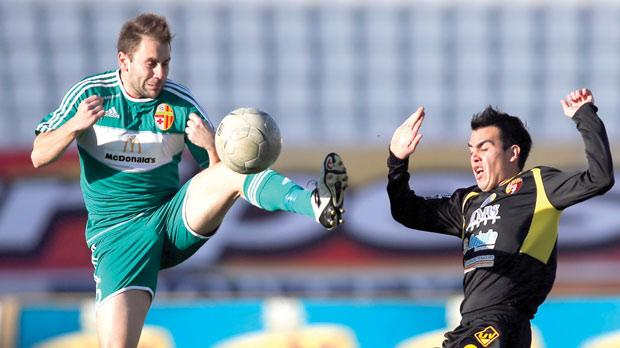 Birkirkara's Paul Fenech jumps to control the ball ahead of Qormi's Edison Bilbao Zarate during yesterday's match at the National Stadium. Photo: Darrin Zammit Lupi