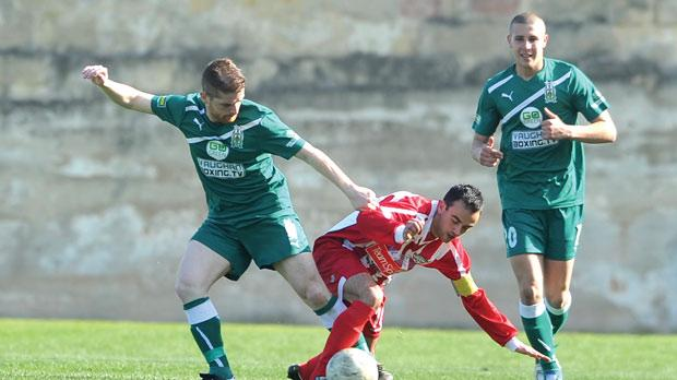 Floriana's Thomas Paris battles for the ball with Dylan Grima. Photo: Stephen Gatt