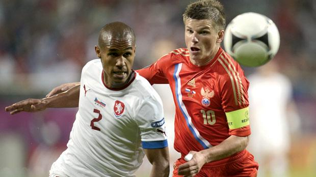 Russia's Andrey Arshavin (right) in a duel with Theodor Selassie.