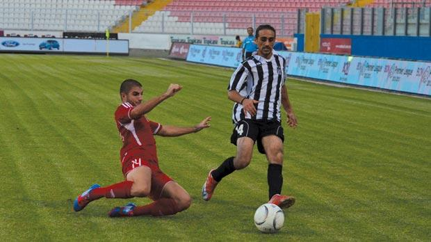 Melita's Luke Micallef (left) in a tackle on Christian Muscat, of Rabat Ajax, yesterday. Photo: Ian Pace