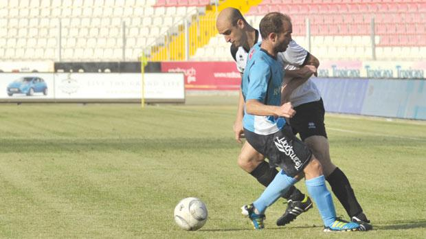 Adrian Pulis (left), of Hibs, tries to go past Ivan Woods, of Sliema Wanderers. Photo: Jason Borg