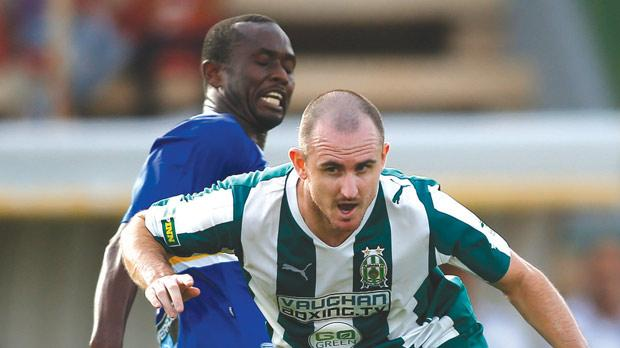 Floriana striker Francis Jeffers is challenged by Orosco Anonam. Photo: Darrin Zammit Lupi