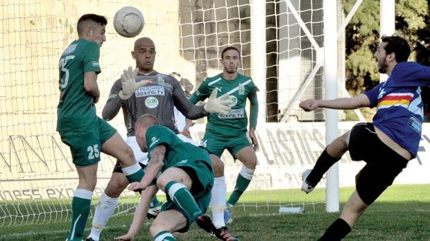 Tarxien's Steve Bonnici (right) shoots at goal against Floriana. Photo: Jason Borg