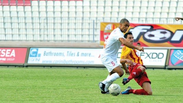 Birkirkara's Gareth Sciberras (left) makes a tackle on Gabriel, of Valletta.