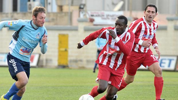 Luigi Ruggiero (left) tries to go past Balzan's Matthew Mendy. Photo: Jason Borg